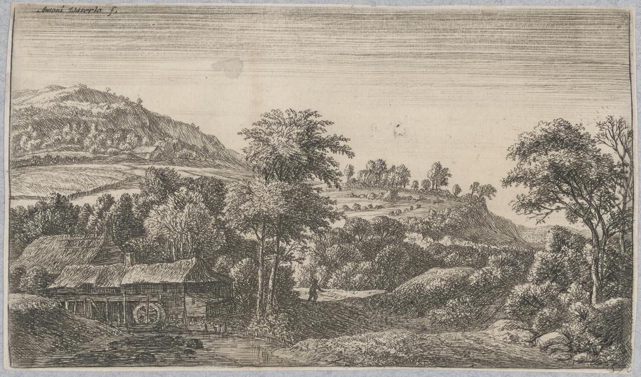 Watermolen aan de voet van een heuvel